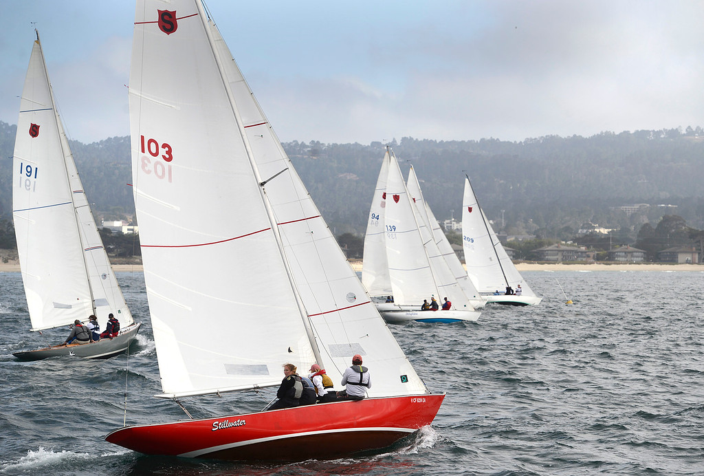 . The fleet of Shield sailboats take off from the starting line off Del Monte Beach in Monterey during the Wednesday Night Series regatta hosted by the Monterey Peninsula Yacht Club on June 22, 2016. (David Royal - Monterey Herald)