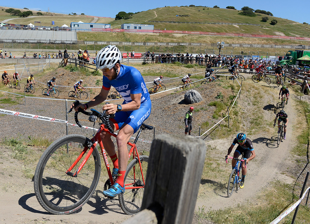 . Ben Frederick, of Leesberg, VA climbs a small mountain of dirt on his way to a third place finish in the men\'s pro cyclocross race during the Sea Otter Classic bike festival at Laguna Seca Raceway in Monterey on Saturday April 16, 2016.  (David Royal - Monterey Herald)