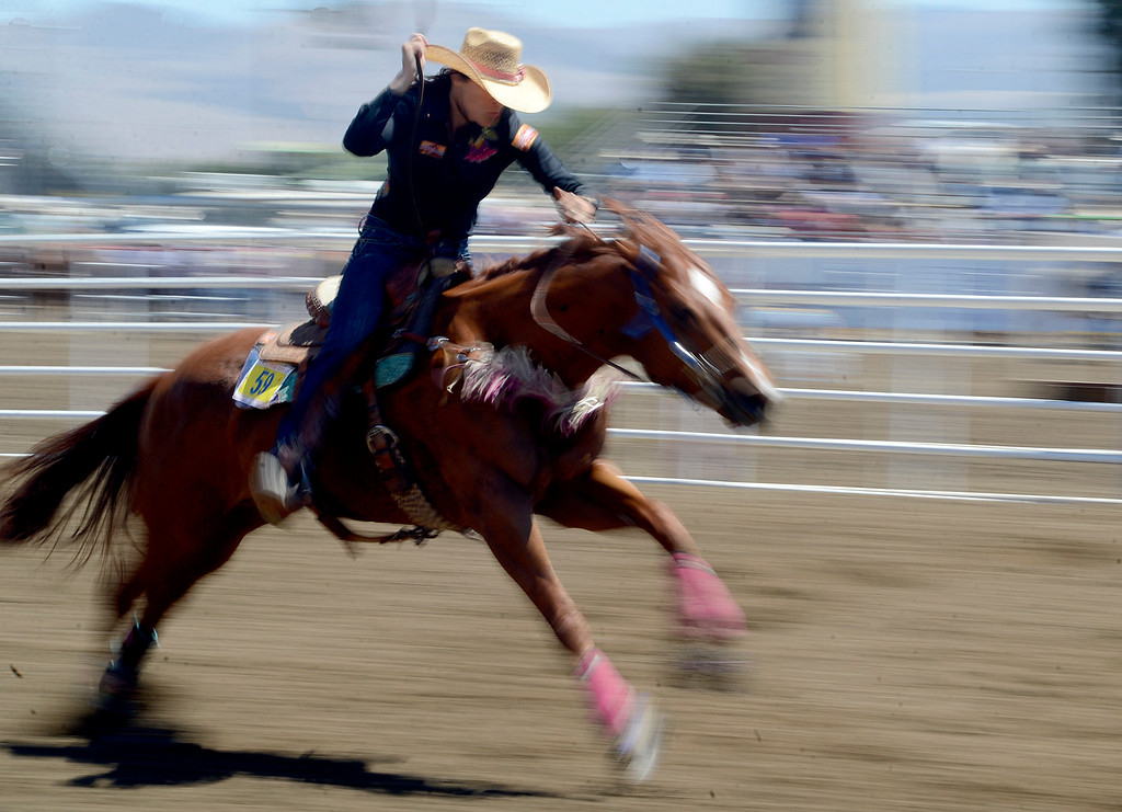. Katy Bray of Banning, CA barrell races during the California Rodeo Salinas at the Salinas Sports Complex on Friday July 22, 2016. (David Royal - Monterey Herald)