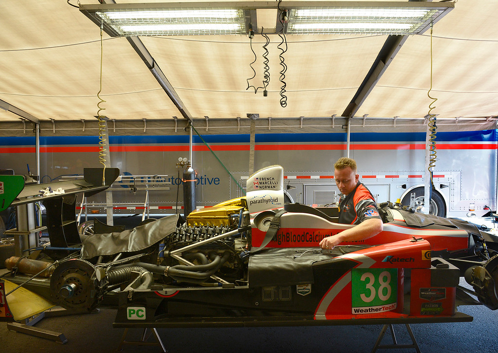 . Mechanic Mike Ansbaugh works inside the cockpit of a prototype race car in the Performance Tech Team tent during the Monterey Grand Prix at Laguna Seca Raceway in Monterey on Friday April 29, 2016. (David Royal - Monterey Herald)