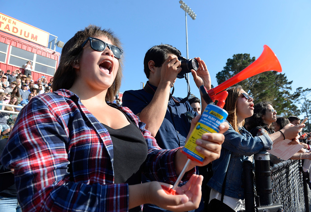 . Jessica Natale blows a horn as friends recieve their diplomas during Pacific Grove High School Graduation on Friday May 27, 2016.  (David Royal - Monterey Herald)