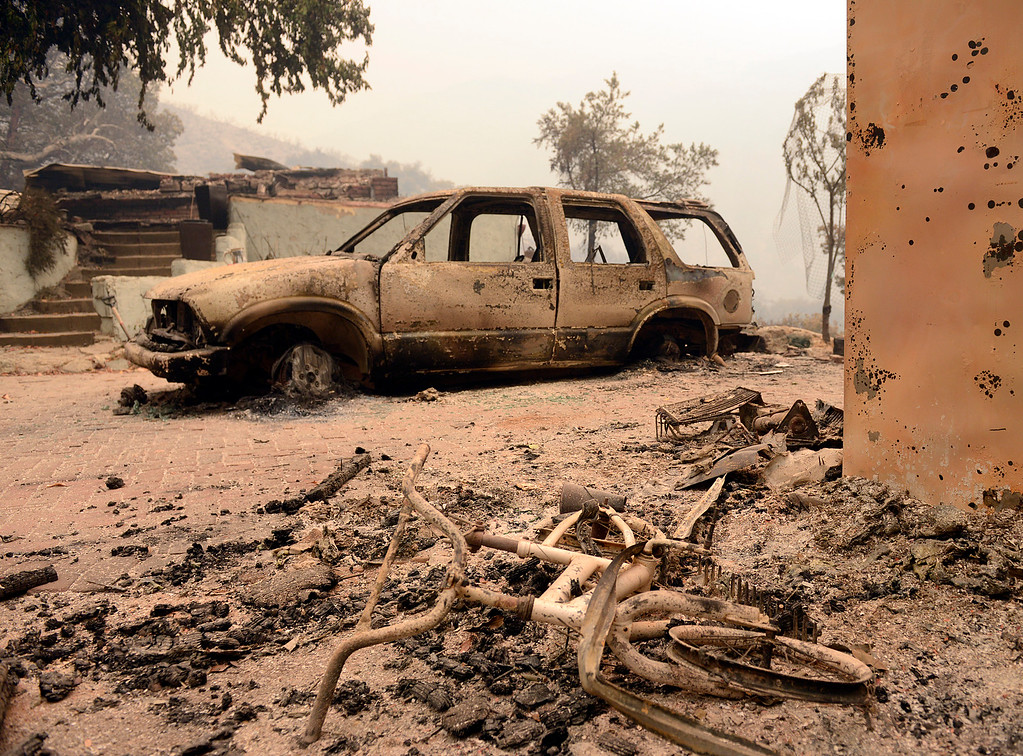 . A burnt bicycle and car sit beside the ruins of a home that was destroyed by the Soberanes Fire in Palo Colorado Canyon on the northern Big Sur Coast on Tuesday July 26, 2016. (David Royal - Monterey Herald)