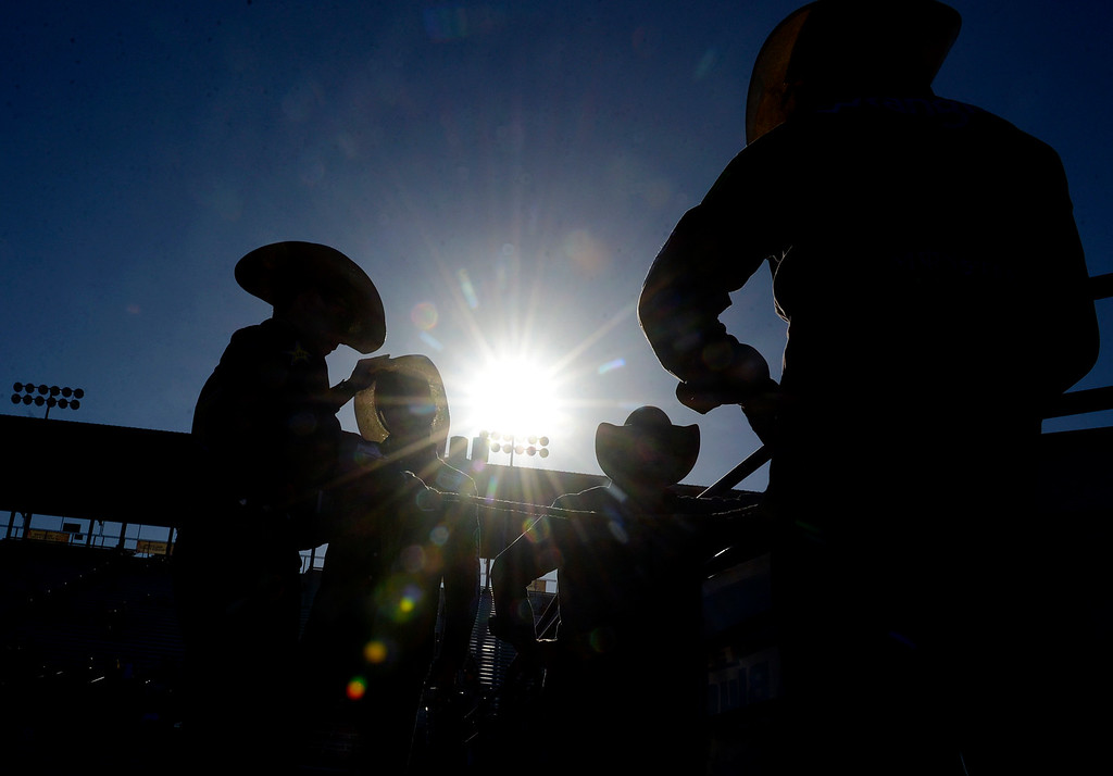 . Bull riders get ready before the Professional Bull Riding event at the Salinas Sports Complex on Wednesday July 20, 2016.(David Royal - Monterey Herald)