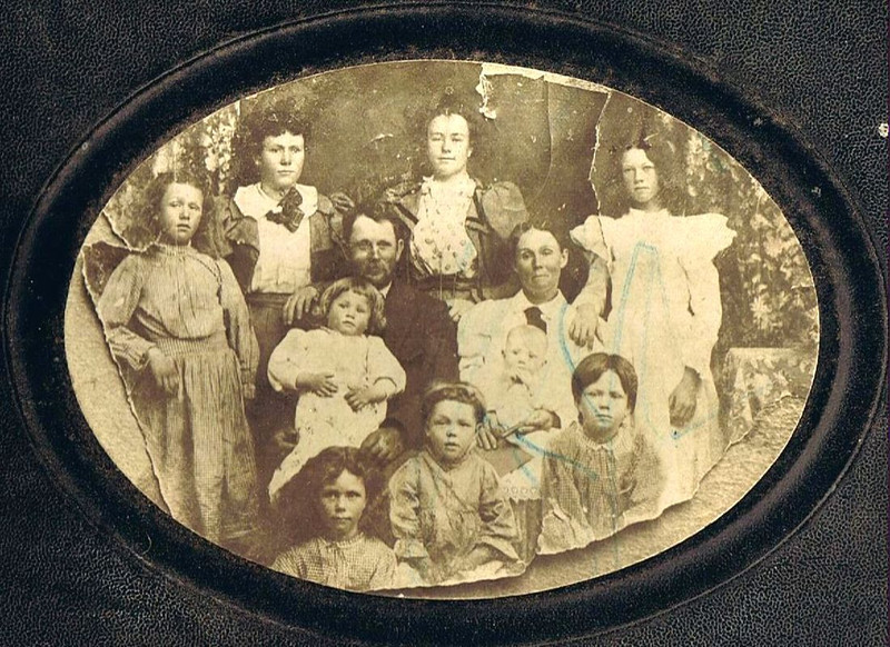 David & Hilie Yaden Family - 1900 - Shoshone, ID  (David age 45, Hilie age 42)<br /> <br /> Top L to R :  Hilie Della (age 13), Anna May (age 21), Elizabeth (age 23), Janice (age 16)<br /> Middle:  David holding Byron William (age 3), Hilie holding William David (age 9 mos)<br /> Bottom L to R:  Minnie Melvina (age 11), Ella Pearl (age 5), Lily Gertrude (age 10)