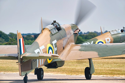 Hawker Hurricane Mk12A G-HURI P3700 RF-E and Hawker Hurricane G-ROBT P2902 Mk.1 Taxiing out at Flying Legends Airshow 2018 By David Stoddart