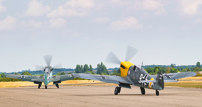 Hispano HA-1112-M4L Buchon White 9 G-AWHH and Hispano HA-1112-M4L Buchon Red 11 G-AWHC Twin Seater taxiing out at Flying Legends Airshow 2018.  By David Stoddart