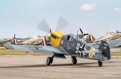 Not a sight you expect to see! Hispano HA-1112-M4L Buchon White 9 G-AWHH Taxiing out in front of 4 Hawker Hurricanes at Flying Legends Airshow 2018  By David Stoddart