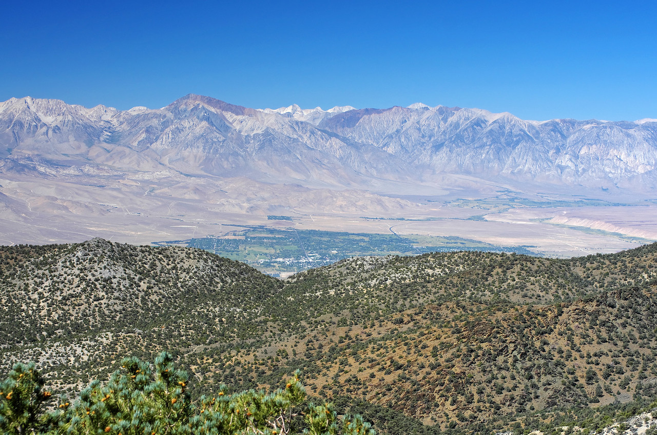 Looking down on the City of Bishop from the Sierra View Point Vista.  Mount Tom in the background and the Ownes River in the righthand portion of the picture.
