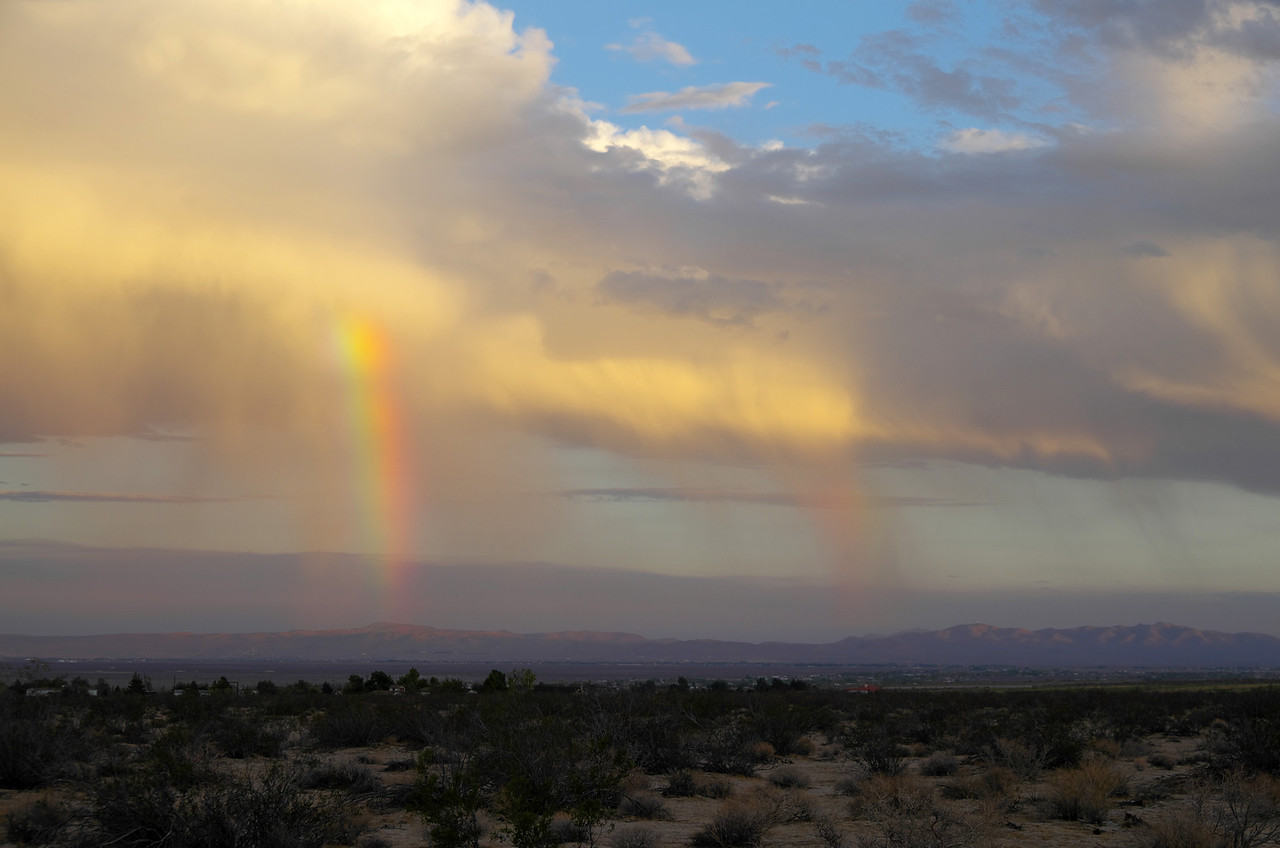 A Mojave Rainbow in the distance.  Taken along Highway 395 near  Coyote Trail Ave, Pearsonville, CA.