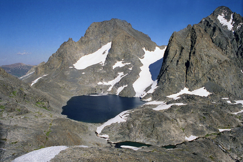 Looking down on Lake Catherine gaurded by Banner Peak and Mt Riter