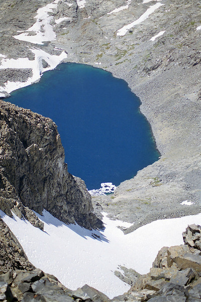 Looking down on Lake Catherine from atop of Banner Peak