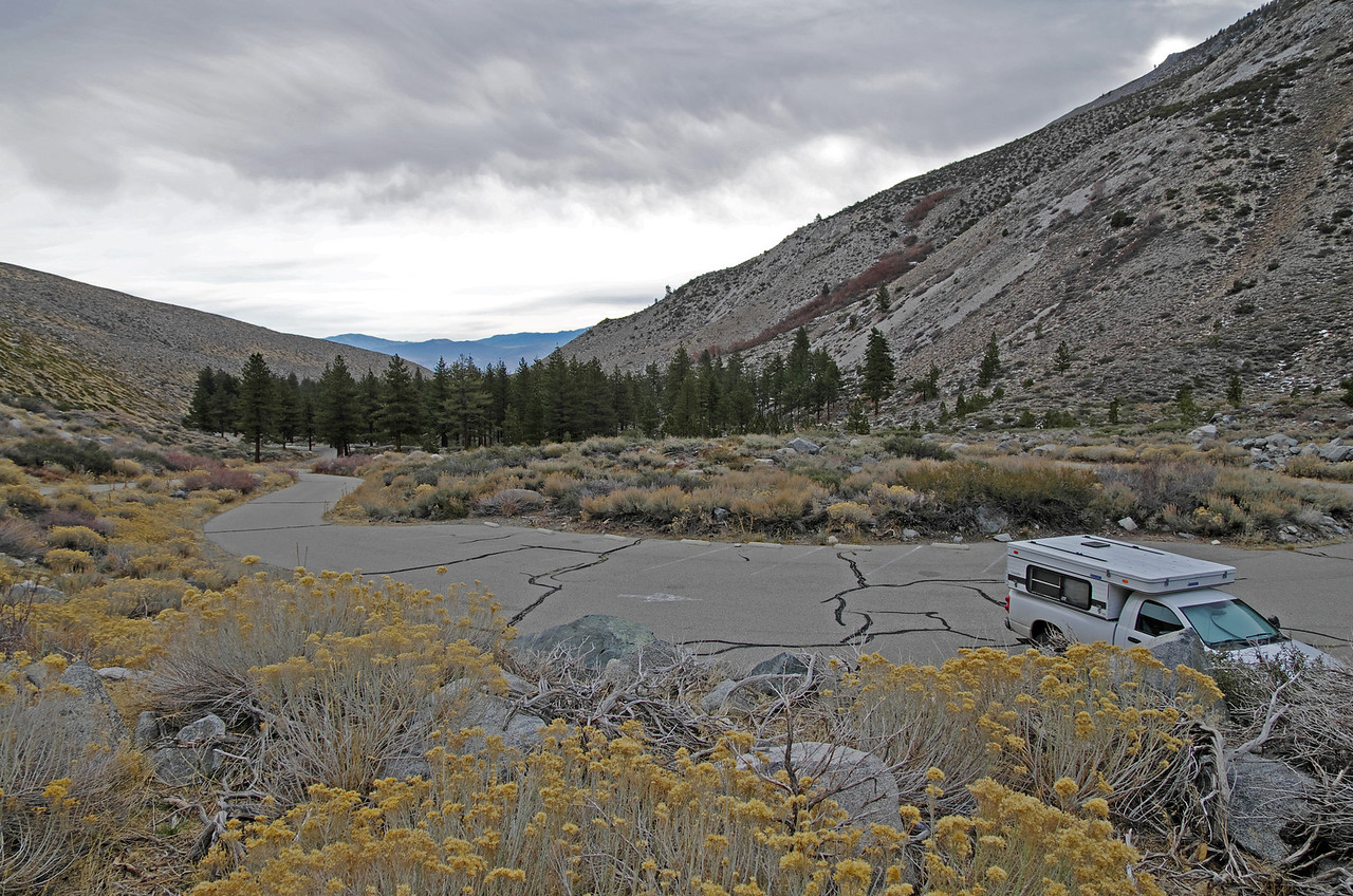 Looking down onto the lower Big Pine Creek trailhead parking lot from the upper trailhead parking lot.