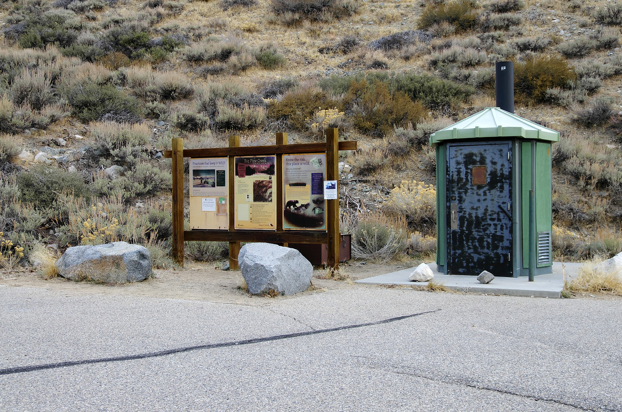 Big Pine Creek Trailhead info, bear storage box, & public toilet at the upper trailhead parking lot.