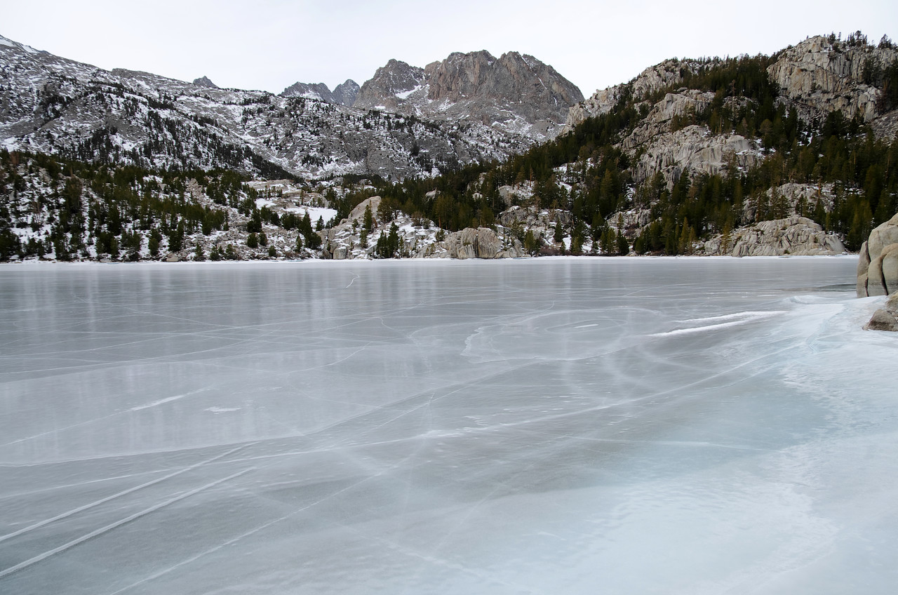 All frozen over lakes have cracks in the ice and you'll even hear it cracking--nothing to be alarmed about, it's normal.