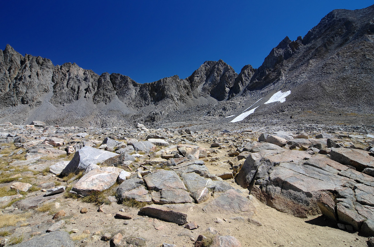 Atop of Bishop Pass from left to right; Jigsaw Pass and Aperture Peak in the background.
