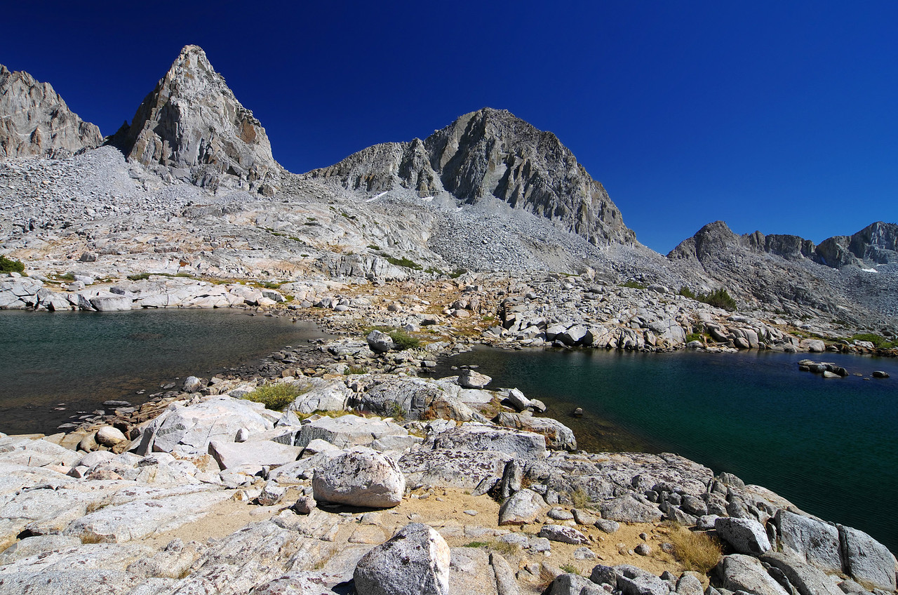 Isosceles Peak and Columbine Peak centered between the middle of the 2nd highest Lake as seen here in this photo.  Knapsack Pass is just to the right of Columbine Peak.