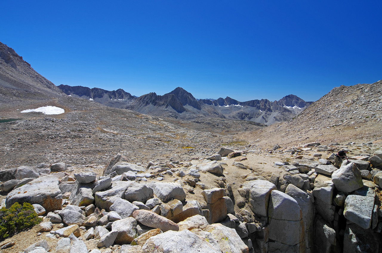 Looking into the Dusy Basin from Bishop Pass.  My friend Ben finds a more interesting vantage point.