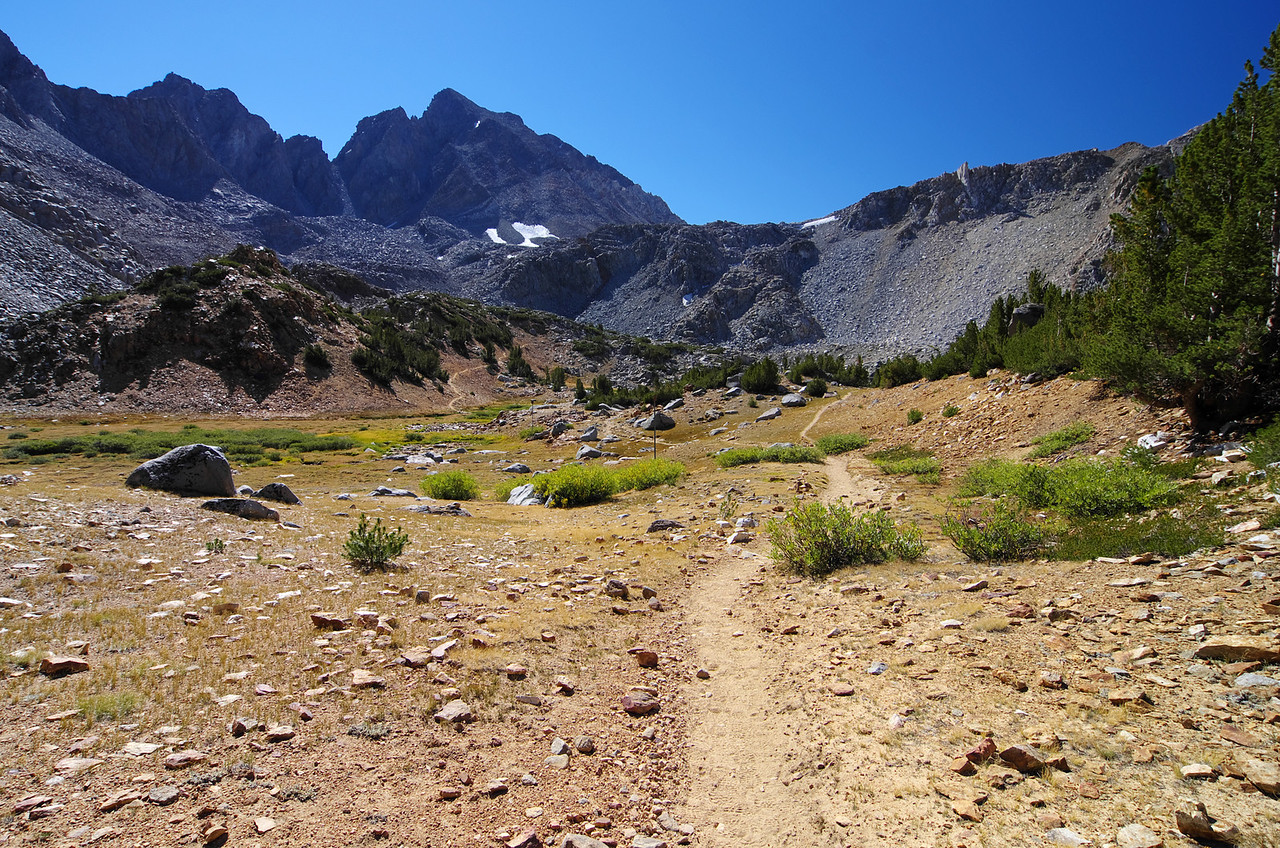 The main trail goes to the left in the distance, but Ben and I will refuel our water supply by going to the trail straight ahead that takes you to Bishop Lake.