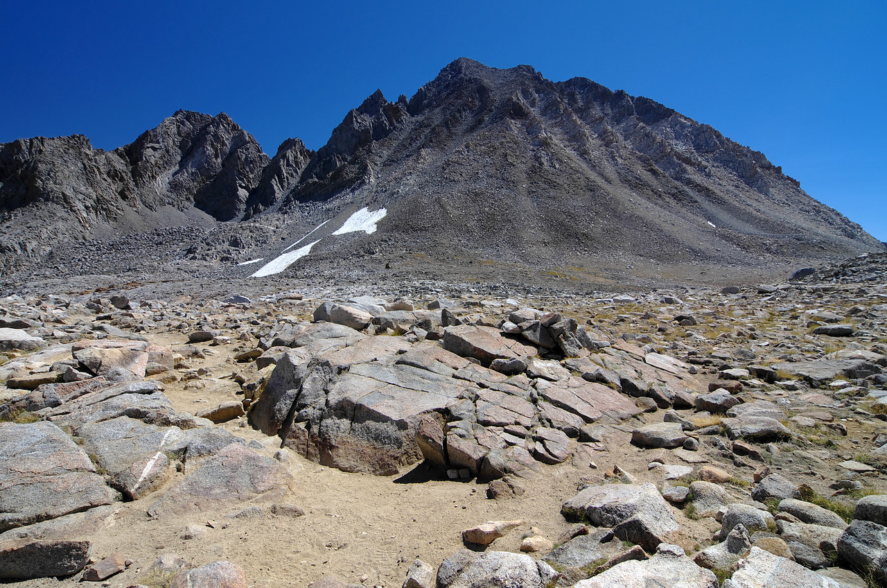 Atop of Bishop Pass with Mount Agassiz and Aperture Peak in the background.