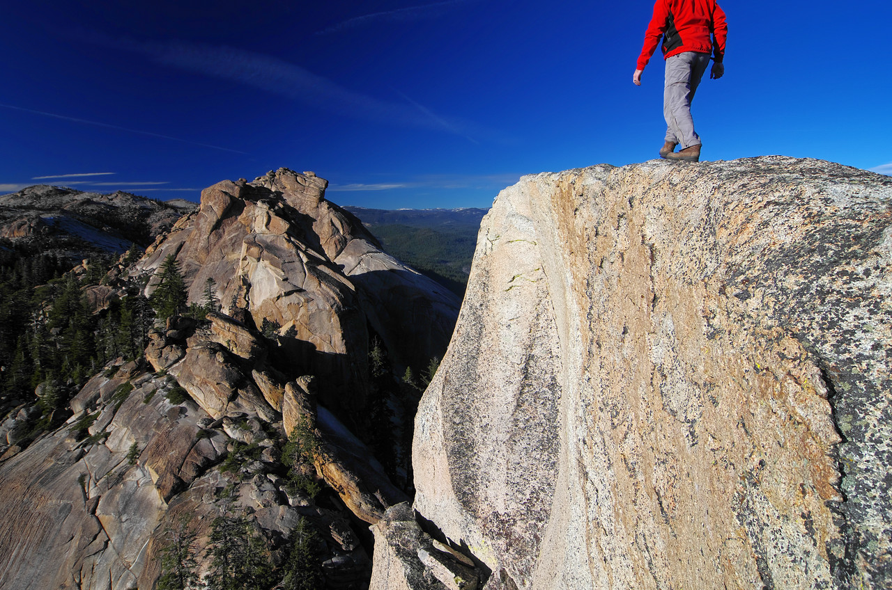 Walking towards the western edge along the summit of the lower Eagle Beak Peak.