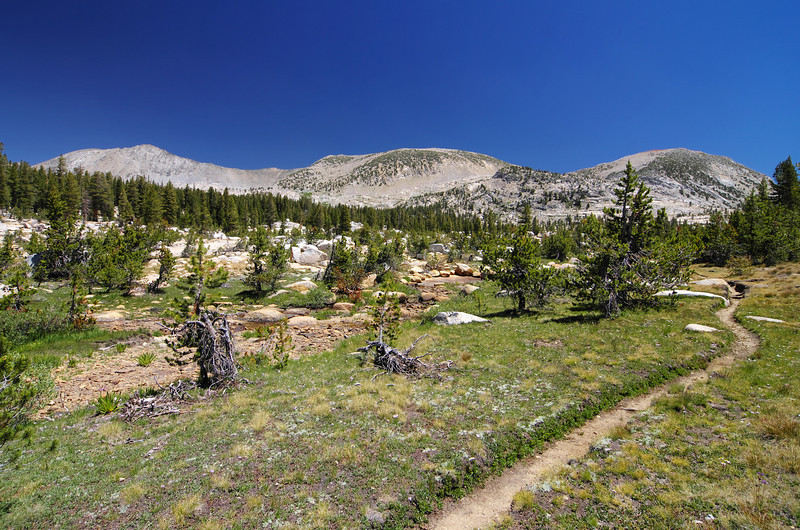 About 12.2 miles in 10,200ft the trail winds it's way through the Red Mtn Basin.