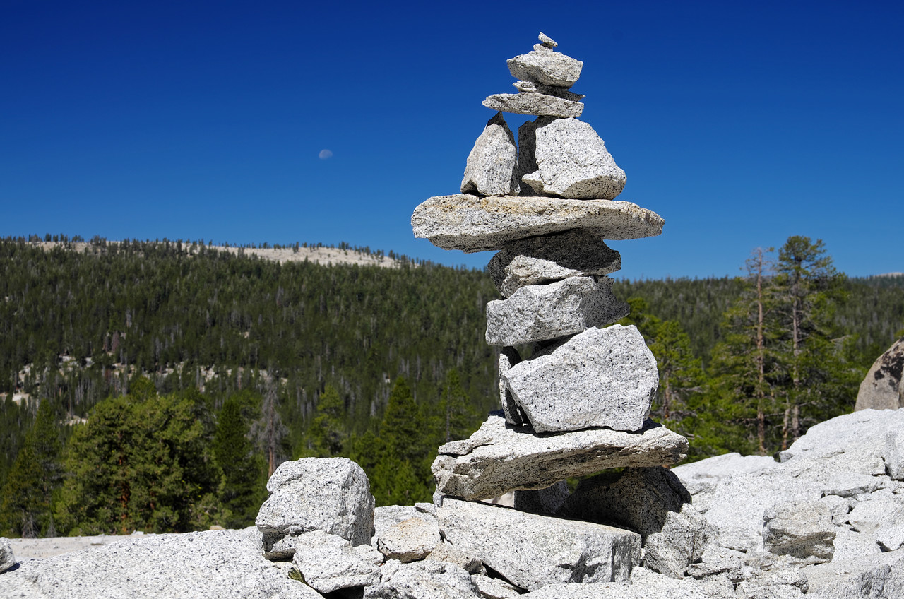 One perched stack of rocks remains, the other has tumbled down.