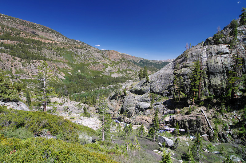 The perceived location of the middle fork of the San Joaquin River comes into view as you descend the Shadow Creek Trail below Shadow Lake.