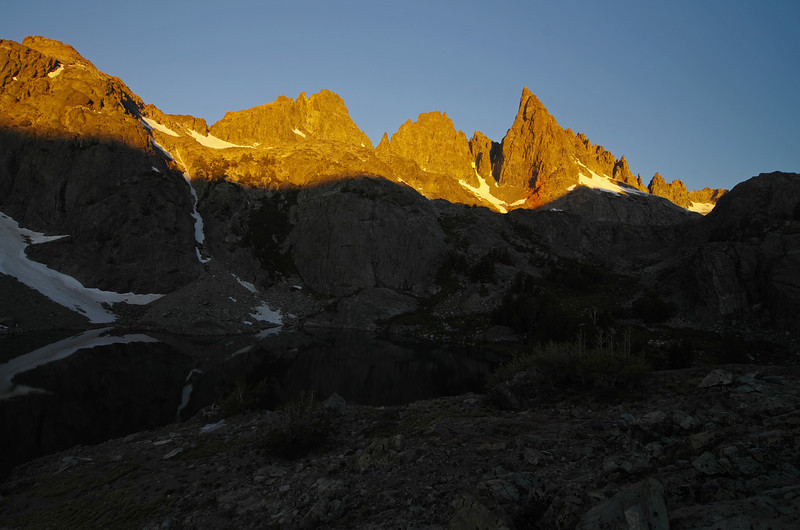 Early mornimg alpine glow lights the tops of the Mammoth Minarets like candles.