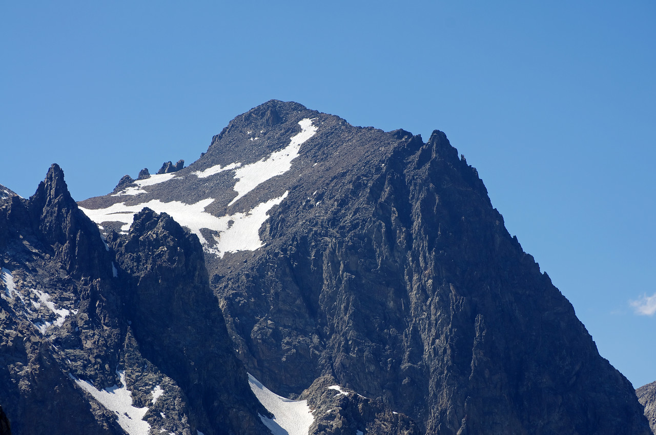 Mount Ritter with a late afternoon shadow cast upon it's east face, as seen through my telephoto lens from near the base of the Kehrlein Minaret.