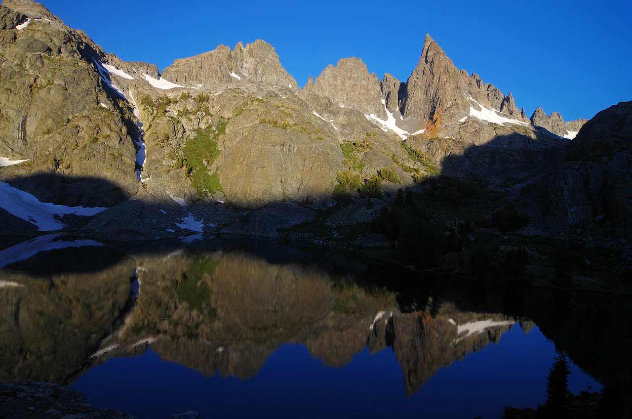The Mammoth Minarets start to reflect off of the NW end of the Lake.