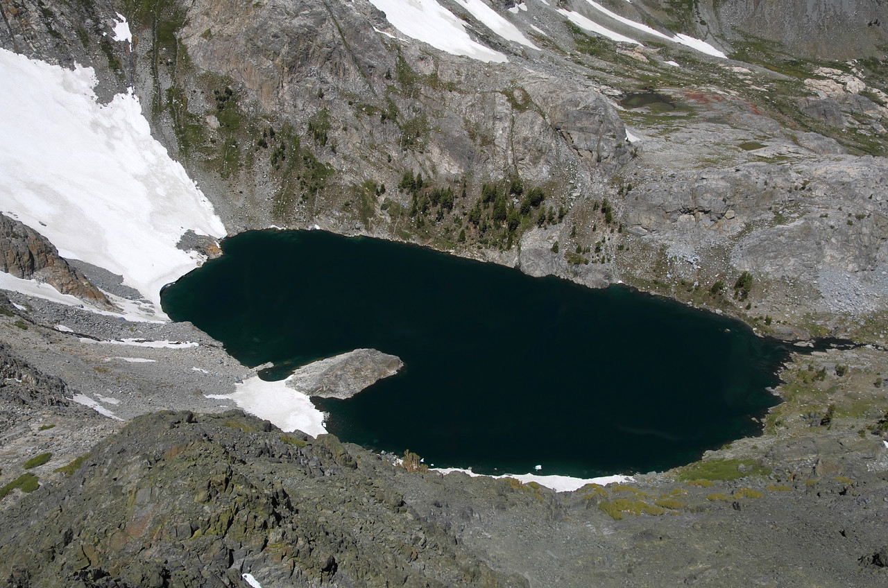 My 2nd-lowest handle view atop of Volcanic Ridge is around 11,200ft.  Iceberg Lake as seen down below from my vantage point, sits at 9,777ft.