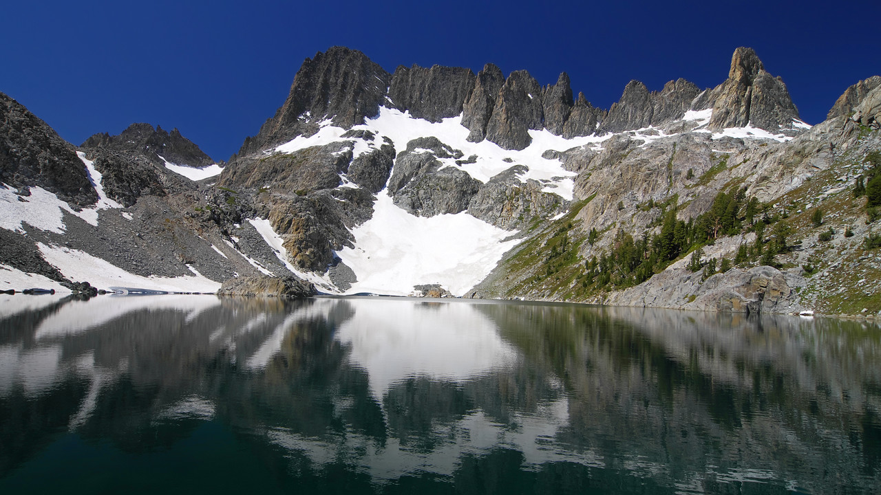 The water in Iceberg Lake is a little calmer than that of Cecil Lake.
