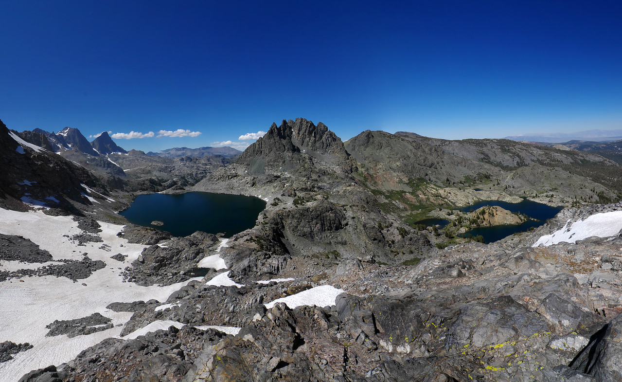 From left to right; Mount Ritter, Banner Peak, Cecil Lake, Volcanic Ridge, and Minaret Lake.  Mount Dana is also worth mentioning.  It's in the far distance between Cecil Lake and Volcanic Ridge.