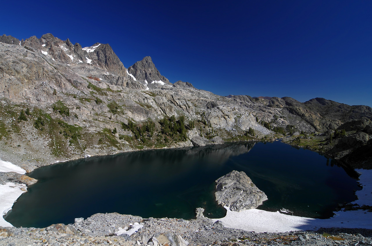 Iceberg Lake below with Mount Ritter and Banner Peak in the distance.