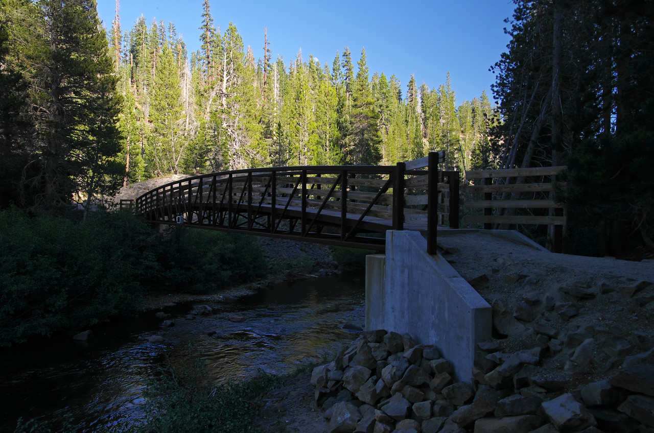 "The bridge that crosses the middle fork of the San Joaquin River from the Devils Postpile trail to the John Muir Trail.  Notice the camera on the bridge, ""What's that for?"""