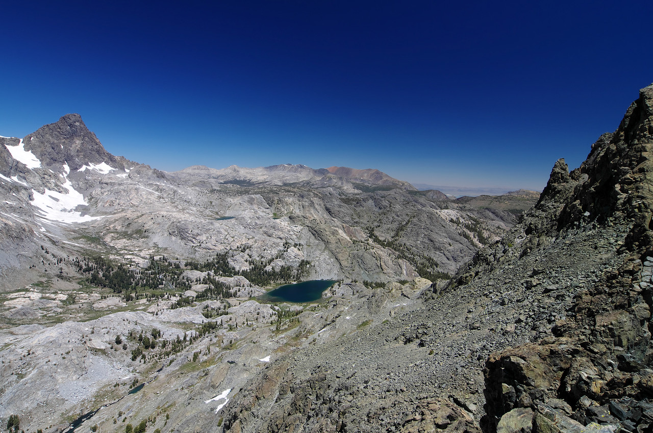 Ediza Lake takes center stage with Banner Peak in the upper left and the ascending western slope of Volcanic Ridge in the right-hand portion of this picture.