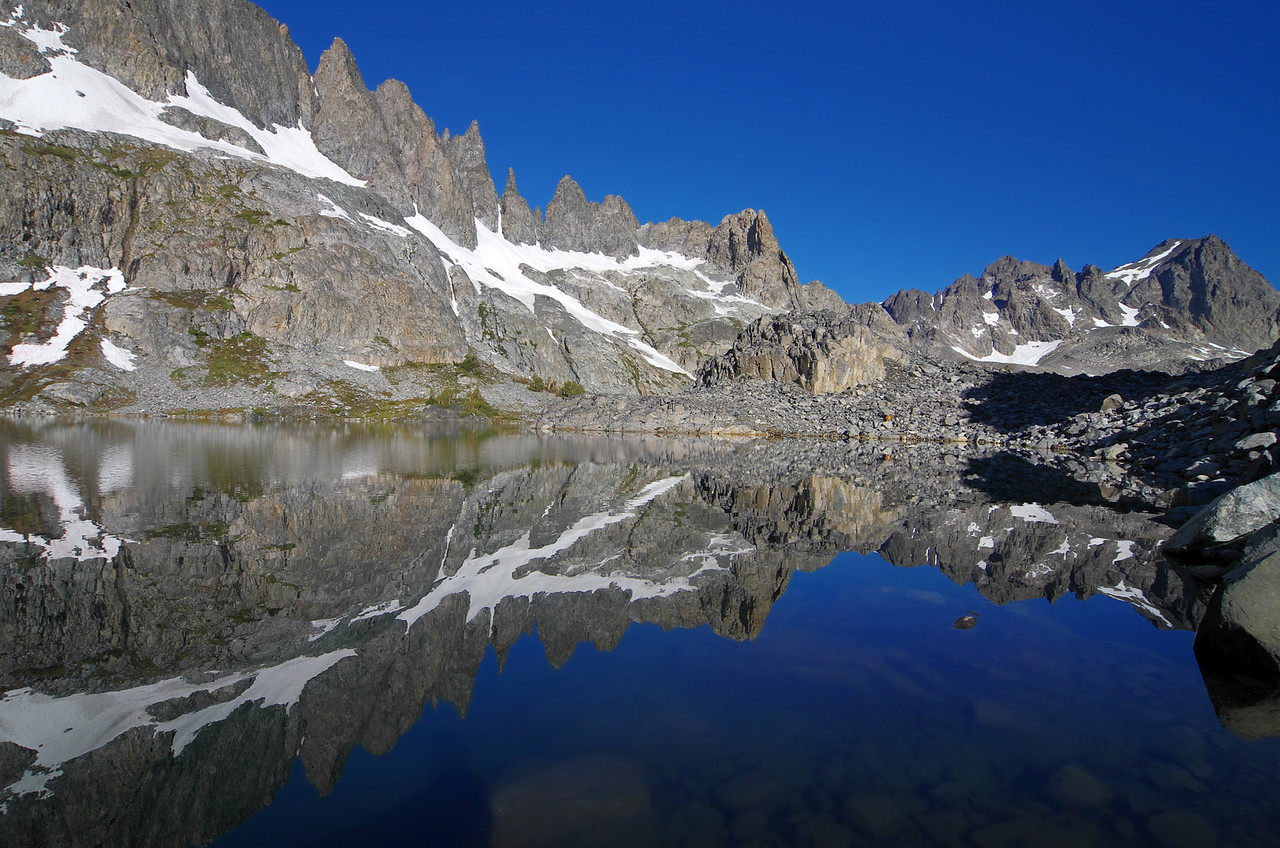 Looking at a fold-like reflection of the Minarets towards the north end of Cecil Lake.