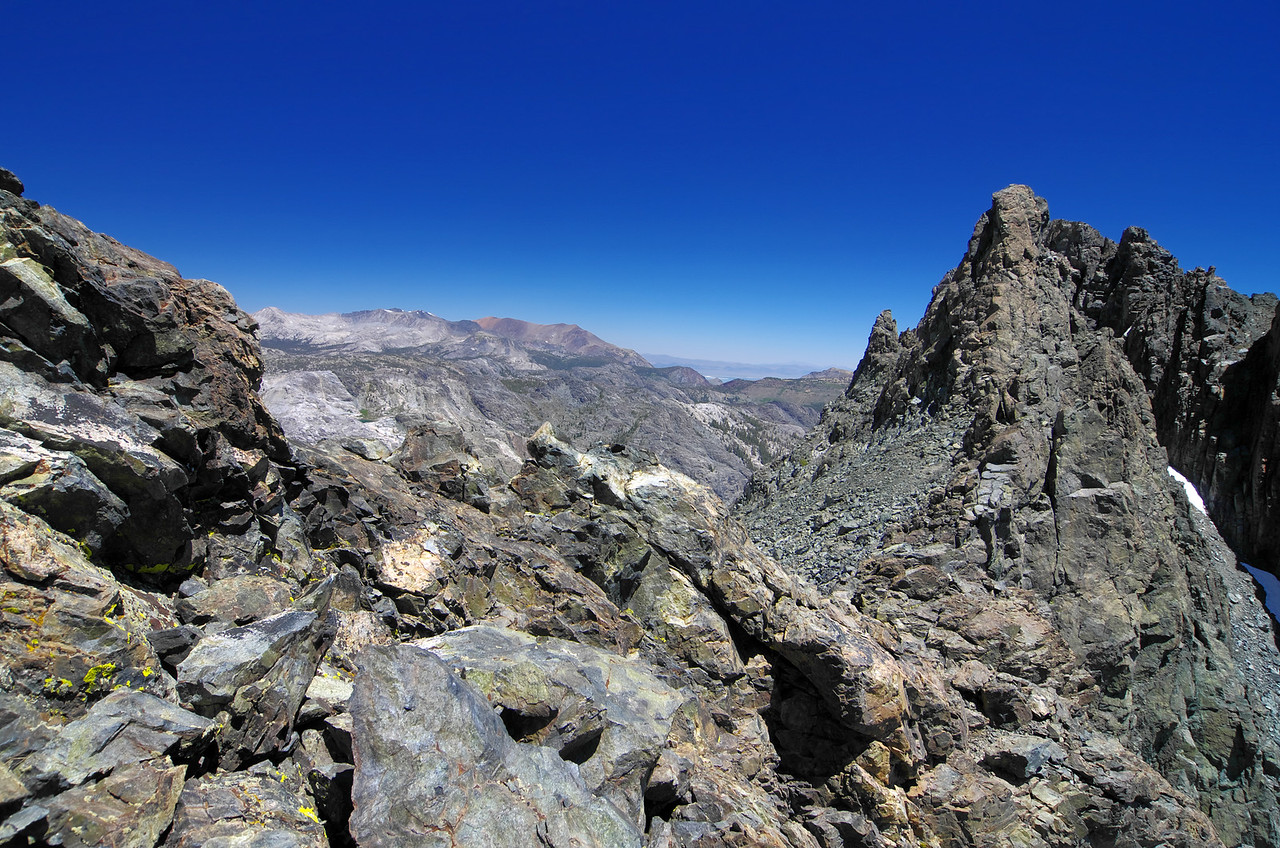 The red volcanic rock of Mount Dana makes it easily identifiable in the center of this picture as down climb the mixed class 3-4 portion of the 2nd lowest handle of Volcanic Ridge.
