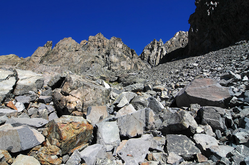 The more challenging route makes its increased degree of difficulty obvious with the introduction large talus and a more suddenly steep slope than the classic route that leads you to the true summit of Volcanic Ridge.