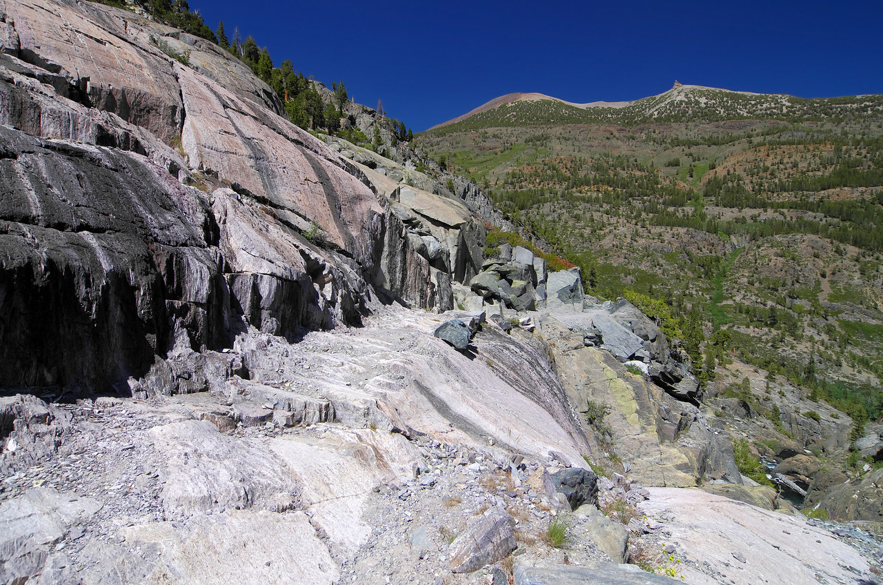 A subtle cliff section along the Shadow Creek Trail below Shadow Lake.