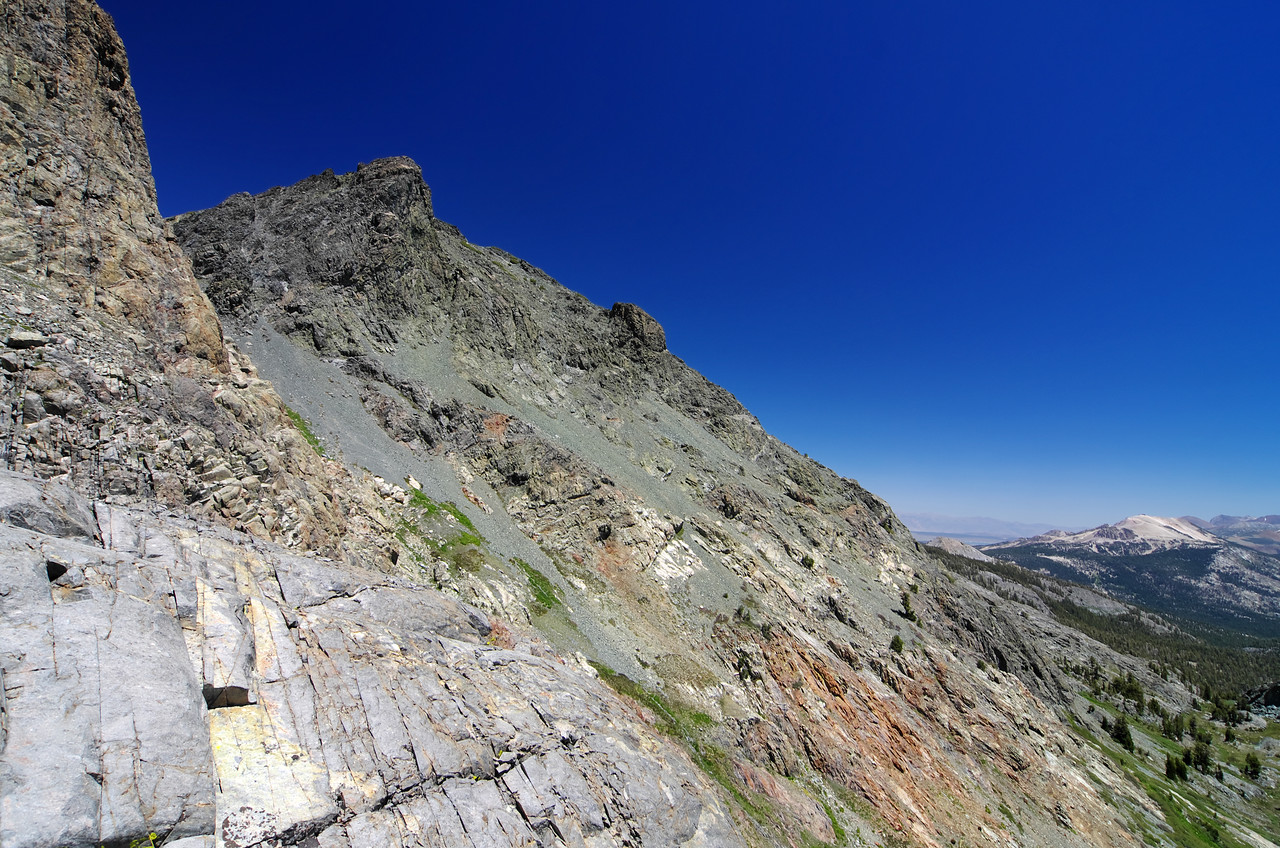 The; easy class 1-2 chute that leads towards the true summit of Volcanic Ridge, vs. the technical class 2-4 chute that leads towards the lower handles of Volcanic Ridge, both ascending from Minaret Lake.  Mammoth Mountain in the right-hand portion of this picture.