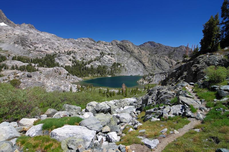 Ediza Lake about a 1/2 mile and 250ft below.