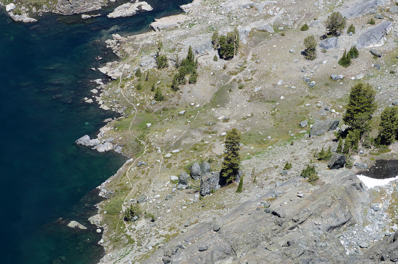 Some hikers as seen down below at the NE end of Iceberg Lake through my telephoto lens.