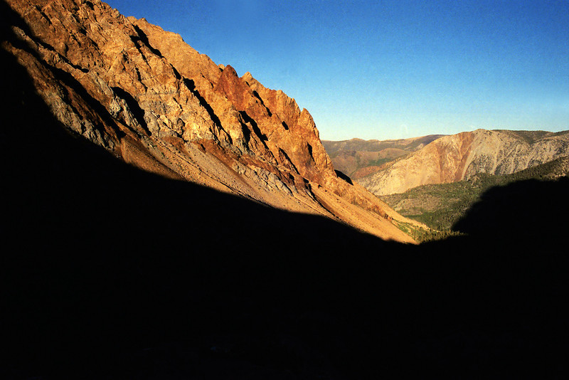 Descending the Piute Pass trail east bound in to the shadow of darkness