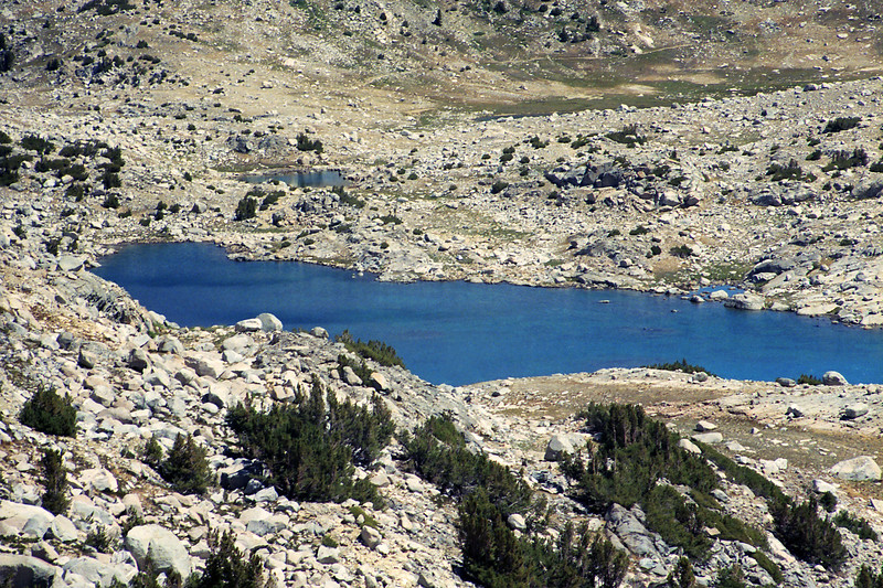 Looking down on Muriel Lake with the Piute Pass Trail West of Piute Pass in the background