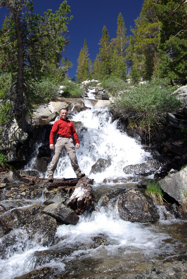David stands in the Waterfall that feeds Peter Pande from Anne Lake