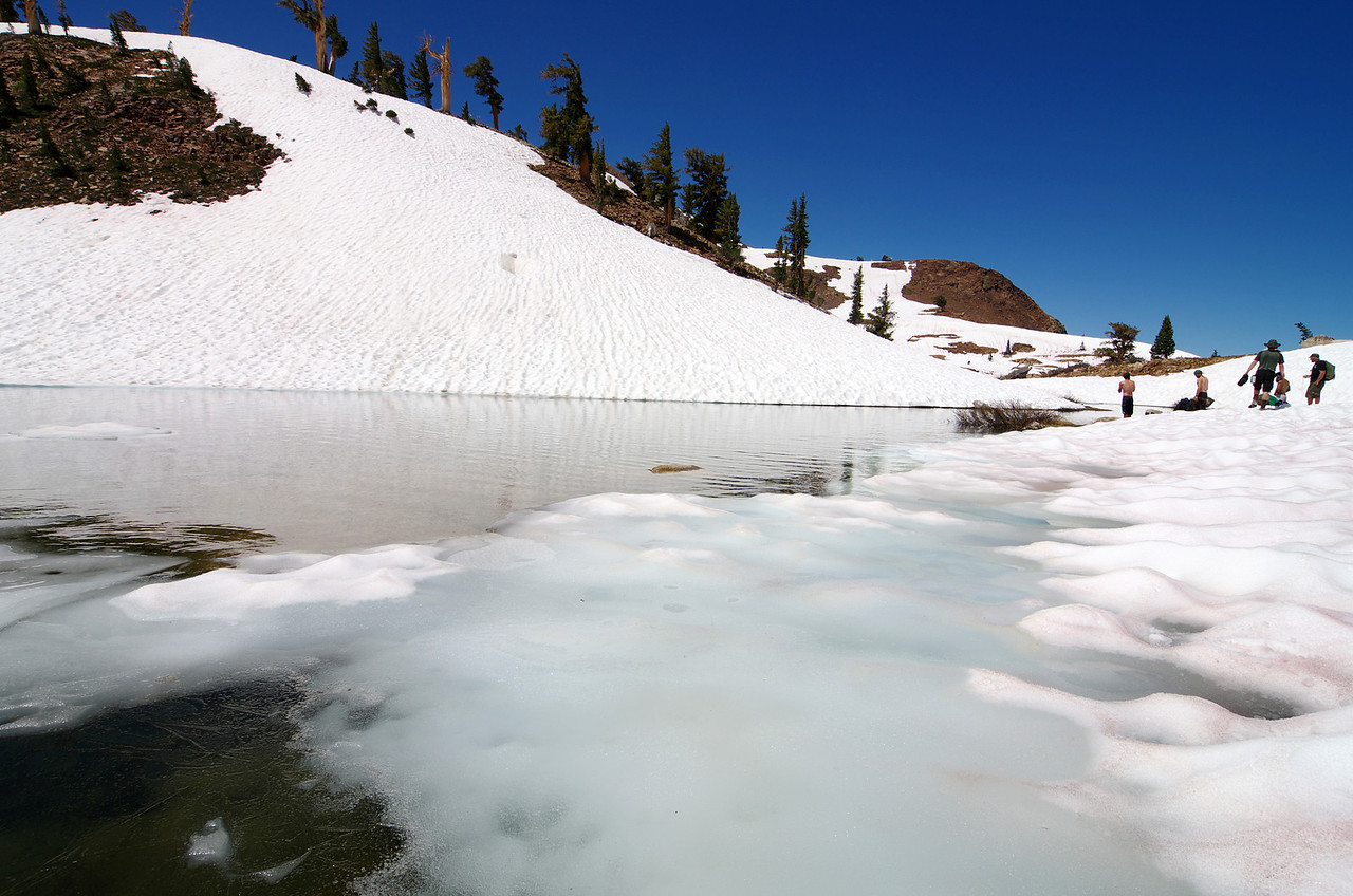 An Icy-Cold lower Monarch Lake and some hikers who want to cool their bodies off.