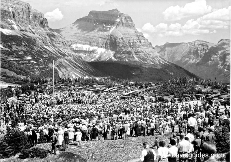 Crowds gathered at summit of Logan Pass for dedication of the Going-to-the-Sun Road, Glacier National Park, 1933
