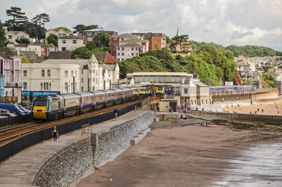 Green liveried 43187  leads 43041 on the 1A81 08:38 Penzance to Paddington, 'The Cornish Riviera', through Dawlish while 43004, leading, with 43079 on the rear, stand in the station with the 1C75 08:35 Paddington to Paignton