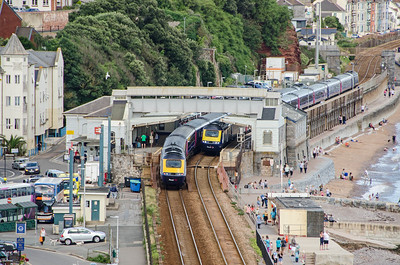 The 5Z70 14:00 Laira to Old Oak Common empty stock passes the 1C83 12:35 Paddington to Paignton which is making it's Dawlish stop headed by 43128 with 43182 on the rear